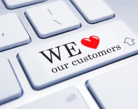 "Une touche d'ordinateur ""We love our customers"""